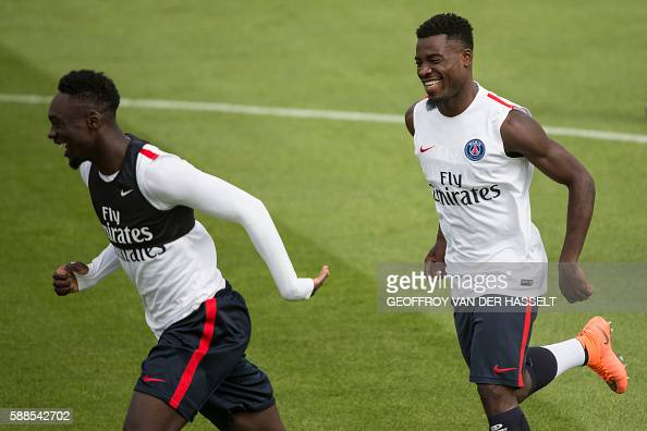 Paris SaintGermain's French midfielder Blaise Matuidi and French forward JeanKevin Augustin take part in a training session at the CampdesLoges in...