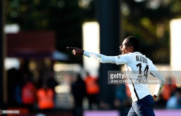 Paris SaintGermain's French midfielder Blaise Matuidi celebrates after scoring during the French L1 football match between Metz and Paris on April 18...