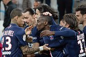 Paris SaintGermain's French midfielder Blaise Matuidi celebrates with teammates after scoring a goal during the French L1 football match between...