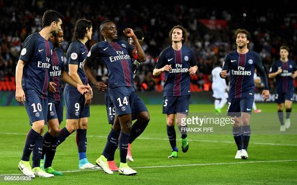 Paris SaintGermain's French midfielder Blaise Matuidi celebrates with his teammates after scoring a goal during the French L1 football match between...