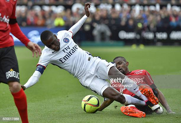 Paris SaintGermain's French midfielder Blaise Matuidi is takled by Guingamp's Senegalese midfielder Moustapha Diallo during the French L1 football...