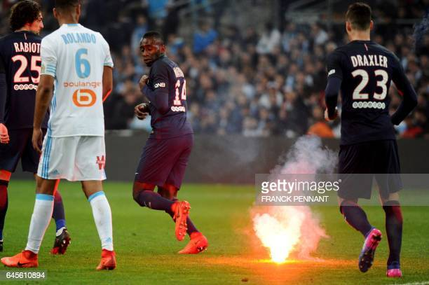 TOPSHOT Paris SaintGermain's French midfielder Blaise Matuidi reacts after flare was thrown on the field during the French L1 football match...