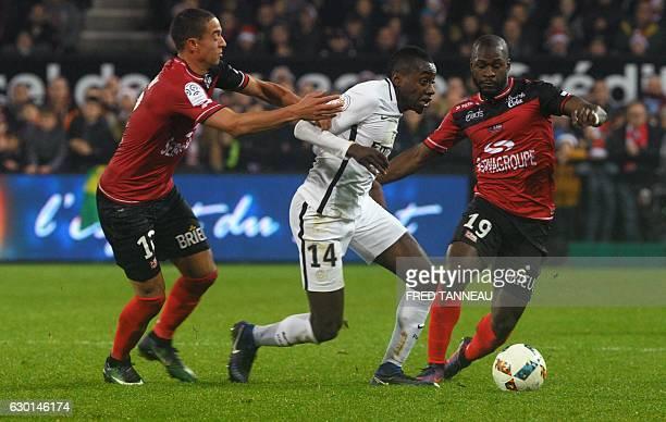 Paris SaintGermain's French midfielder Blaise Matuidi vies with Guingamp's Belgian forward Nill De Pauw and Guingamp's French forward Yannis Salibur...