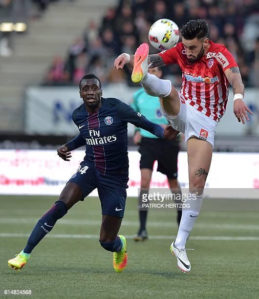 Paris SaintGermain's French midfielder Blaise Matuidi vies with Nancy's SpanishUruguayan defender Erick Cabaco during the French L1 football match...