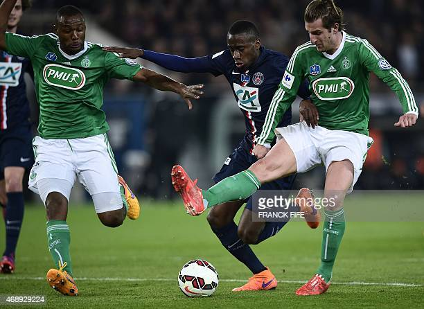 Paris SaintGermain's French midfielder Blaise Matuidi vies with SaintEtienne's French defender Kevin TheophileCatherine and SaintEtienne's French...