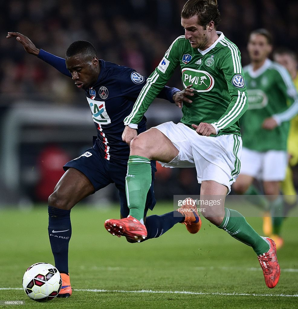 Paris Saint-Germain's French midfielder <a gi-track='captionPersonalityLinkClicked' href=/galleries/search?phrase=Blaise+Matuidi&family=editorial&specificpeople=801779 ng-click='$event.stopPropagation()'>Blaise Matuidi</a> (C) vies with Saint-Etienne's French midfielder <a gi-track='captionPersonalityLinkClicked' href=/galleries/search?phrase=Jeremy+Clement&family=editorial&specificpeople=648908 ng-click='$event.stopPropagation()'>Jeremy Clement</a> during the French Cup semi-final match between Paris Saint-Germain (PSG) and Saint-Etienne (ASSE) on April 8, 2015 at the Parc des Princes stadium in Paris. Paris won 4-1. AFP PHOTO / FRANCK FIFE