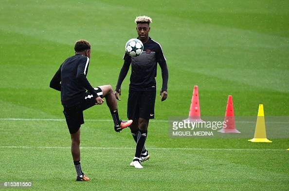 Paris SaintGermain's French midfielder Christopher Nkunku and Paris SaintGermain's French defender Presnel Kimpembe are pictured during a training...