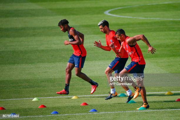 Paris SaintGermain's French midfielder Christopher Nkunku Argentine midfielder Javier Pastore and Brazilian defender Marquinhos take part in a...