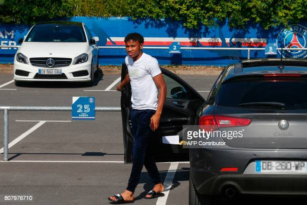 Paris SaintGermain's French midfielder Christopher Nkunku arrives for a training session at the Oredoo training Centre in SaintGermainenLaye on July...