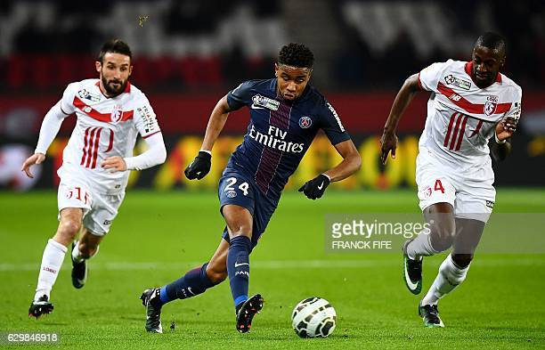 Paris SaintGermain's French midfielder Christopher Nkunku controls the ball in front Lille's French midfielder Younousse Sankhare and Lille's French...