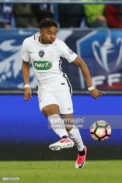 Paris SaintGermain's French midfielder Christopher Nkunku controls the ball during the French Cup football match between Avranches and Paris...