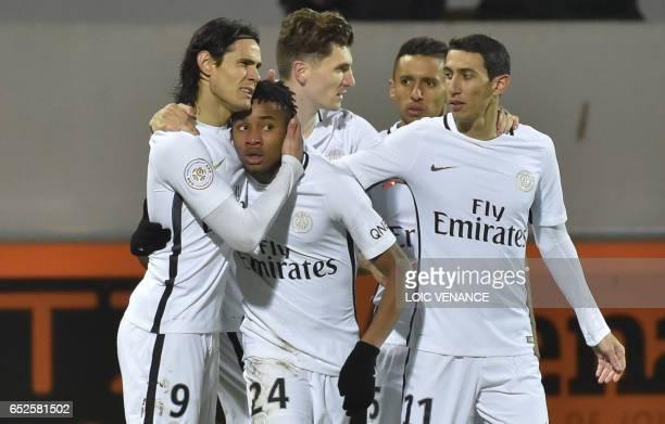 TOPSHOT Paris SaintGermain's French midfielder Christopher Nkunku is congratulated by Paris SaintGermain's Uruguayan forward Edinson Cavani and Paris...