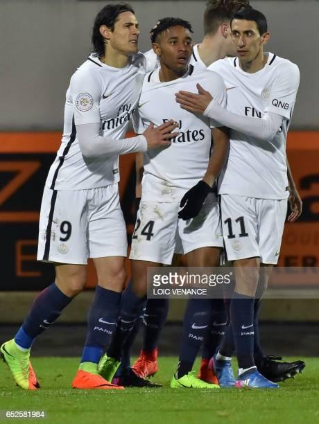 Paris SaintGermain's French midfielder Christopher Nkunku is congratulated by Paris SaintGermain's Uruguayan forward Edinson Cavani and Paris...