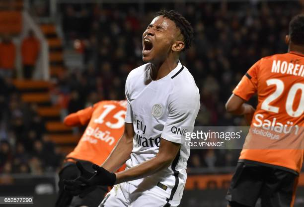 Paris SaintGermain's French midfielder Christopher Nkunku reacts during the French L1 football match Lorient vs Paris SG at the Moustoir stadium in...