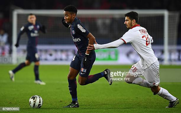 Paris SaintGermain's French midfielder Christopher Nkunku vies with Lille's French defender Benjamin Pavard during the French League Cup football...