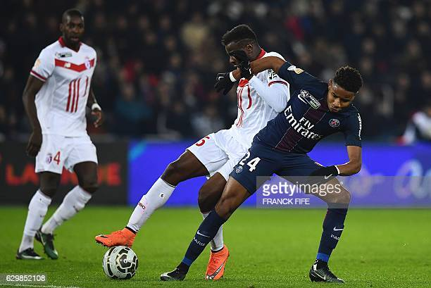 Paris SaintGermain's French midfielder Christopher Nkunku vies with Lille's French midfielder Ibrahim Amadou during the French League Cup football...