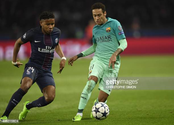 Paris SaintGermain's French midfielder Christopher Nkunku vies with Barcelona's Brazilian forward Neymar during the UEFA Champions League round of 16...