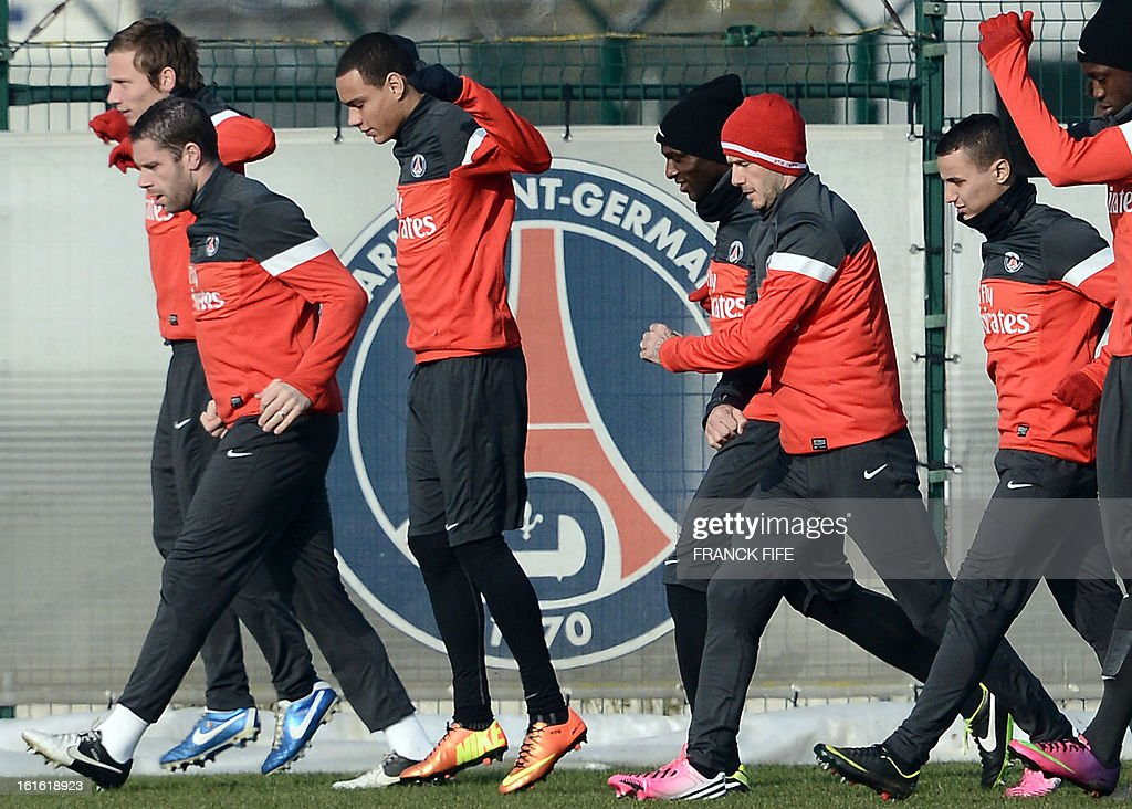 Paris Saint-Germain's French midfielder Clement Chantome, French defender Sylvain Armand, Dutch defender Gregory Van Der Wiel, French defender Zoumana Camara and British midfielder David Beckham attend a training session on February 13, 2013 at the club's Camp des Loges training center in Saint-Germain-en-Laye, near Paris. Beckham, PSG's latest prized signing, is taking part in his first full training session today, with the view to possibly making his debut in February 17's L1 match at Sochaux.