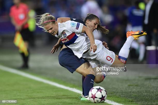 Paris SaintGermain's French midfielder Eve Perisset vies with Lyon's French midfielder Eugenie Le Sommer during the UEFA Women's Champions League...