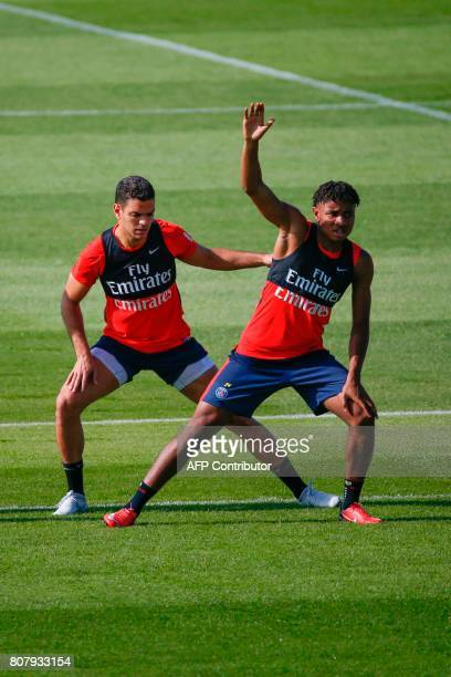 Paris SaintGermain's French midfielder Hatem Ben Arfa and French midfielder Christopher Nkunku take part in a training session at the Oredoo training...