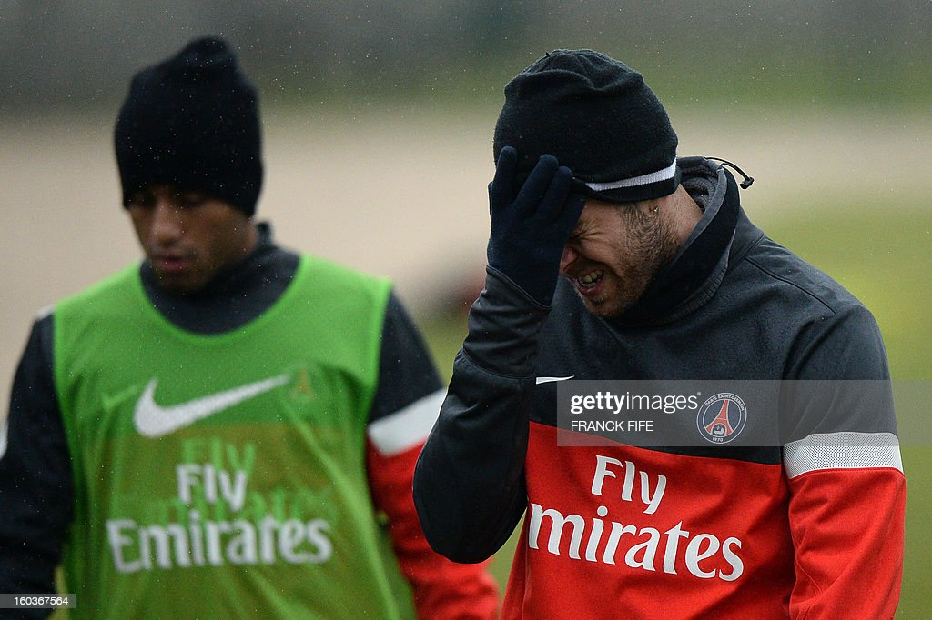 Paris Saint-Germain's French midfielder Jeremy Menez (R) grimaces during a training session on January 30, 2013 at the Camp des Loges in Saint-Germain-en-Laye, west of Paris. AFP PHOTO / FRANCK FIFE