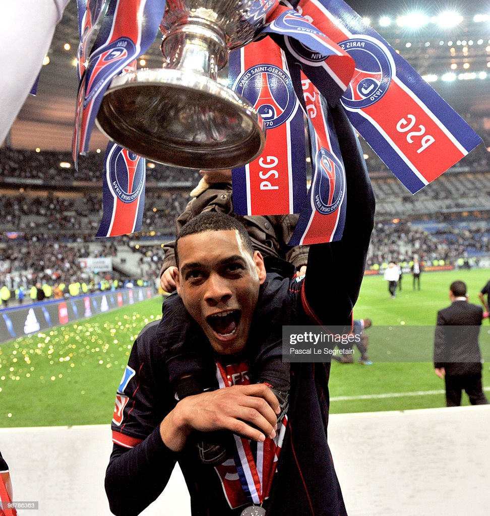 Paris Saint-Germain's French striker <a gi-track='captionPersonalityLinkClicked' href=/galleries/search?phrase=Guillaume+Hoarau&family=editorial&specificpeople=5223496 ng-click='$event.stopPropagation()'>Guillaume Hoarau</a> holds the trophy as he celebrates the winning of the French Cup final between Paris Saint Germain football club and A.S Monaco at Stade de France on May 1, 2010 in Paris, France. Paris Saint Germain won 1-0.