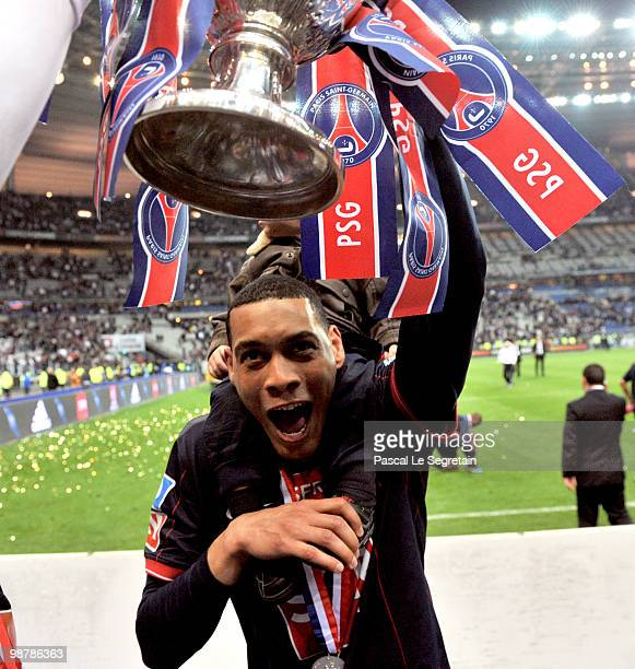 Paris SaintGermain's French striker Guillaume Hoarau holds the trophy as he celebrates the winning of the French Cup final between Paris Saint...