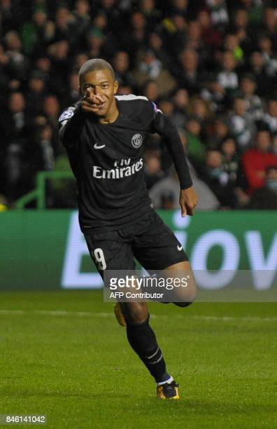 Paris SaintGermain's French striker Kylian Mbappe celebrates after scoring their second goal during the UEFA Champions League Group B football match...