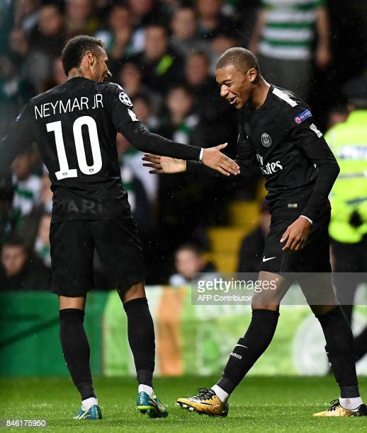 Paris SaintGermain's French striker Kylian Mbappe celebrates with Paris SaintGermain's Brazilian striker Neymar after scoring their second goal...