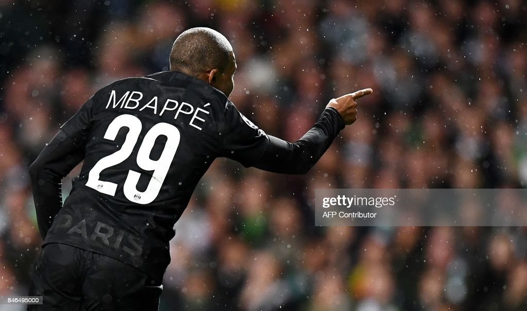 TOPSHOT - Paris Saint-Germain's French striker Kylian Mbappe reacts during the UEFA Champions League Group B football match between Celtic and Paris Saint-Germain (PSG) at Celtic Park in Glasgow, on September 12, 2017. PSG won the game 5-0. / AFP PHOTO / Franck FIFE