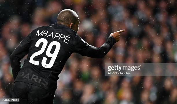 TOPSHOT Paris SaintGermain's French striker Kylian Mbappe reacts during the UEFA Champions League Group B football match between Celtic and Paris...