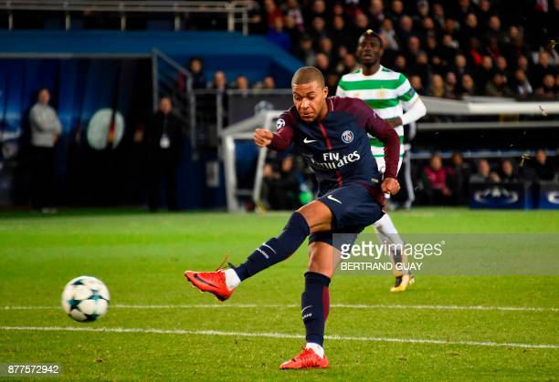 Paris SaintGermain's French striker Kylian Mbappe shoots towards goal during the UEFA Champions League Group B football match between Paris...