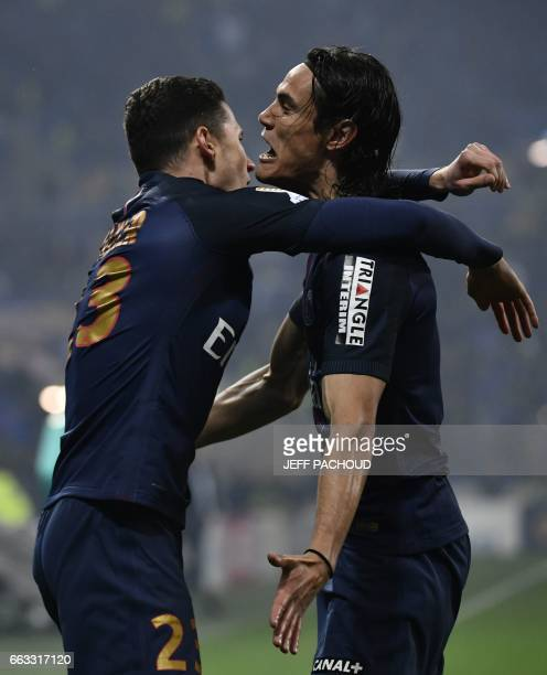 Paris SaintGermain's German forward Julian Draxler celebrate with Paris SaintGermain's Uruguayan forward Edinson Cavani after scoring a goal during...