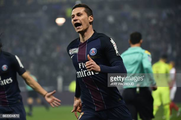 Paris SaintGermain's German forward Julian Draxler celebrates after scoring a goal during the French League Cup final football match between Paris...