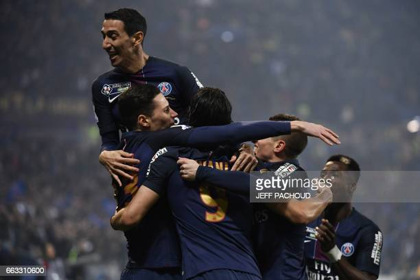 Paris SaintGermain's German forward Julian Draxler celebrates with teammates after scoring a goal during the French League Cup final football match...