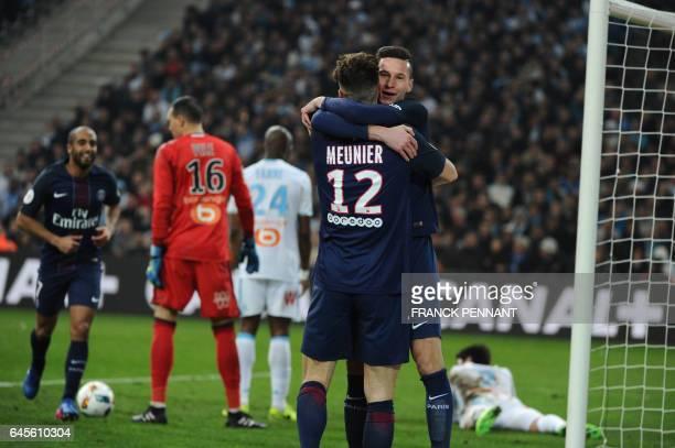 Paris SaintGermain's German forward Julian Draxler is congratulated by teammate Thomas Meunier after scoring a goal during the French L1 football...