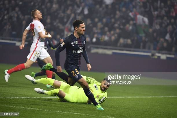 Paris SaintGermain's German forward Julian Draxler reacts as he scores a goal past Monaco's Croatian goalkeeper Danijel Subasic during the French...