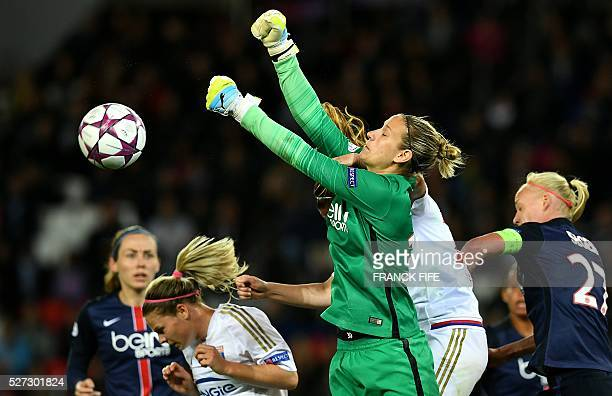 Paris SaintGermain's German goalkeeper AnnKatrin Berger blocks a shot on goal by Lyon's French forward Eugenie Le Sommer during the UEFA Women's...