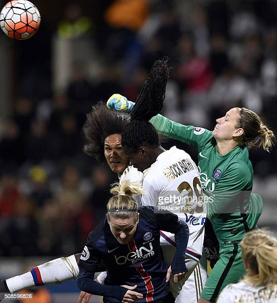 Paris SaintGermain's German goalkeeper AnnKatrin Berger jumps to block the ball next to Lyon's French defender Griedge Mbock and Lyon's French...