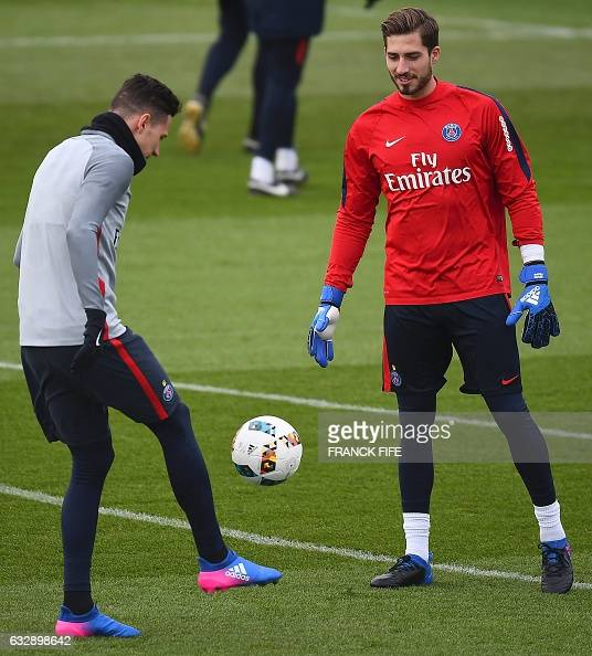 Paris SaintGermain's German goalkeeper Kevin Trapp and German forward Julian Draxle attend in a training session on January 28 2017 in...