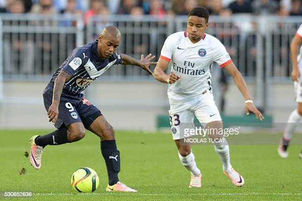 Paris SaintGermain's German midfielder Christopher Nkunku vies with Bordeaux' Uruguyan forward Diego Rolan the French L1 football match between...