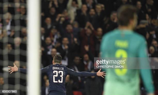 Paris SaintGermain's German midfielder Julian Draxler celebrates after scoring a goal during the UEFA Champions League round of 16 first leg football...