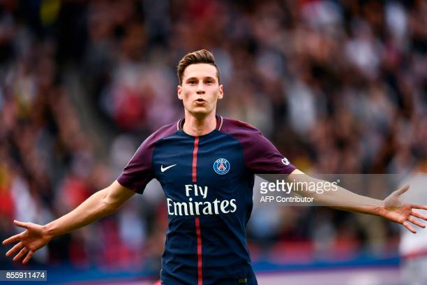 Paris SaintGermain's German midfielder Julian Draxler celebrates after scoring a goal during the French L1 football match Paris SaintGermain vs...