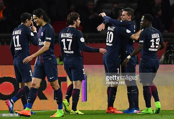 Paris SaintGermain's German midfielder Julian Draxler celebrates with Paris SaintGermain's Argentinian forward Javier Pastore and Paris...