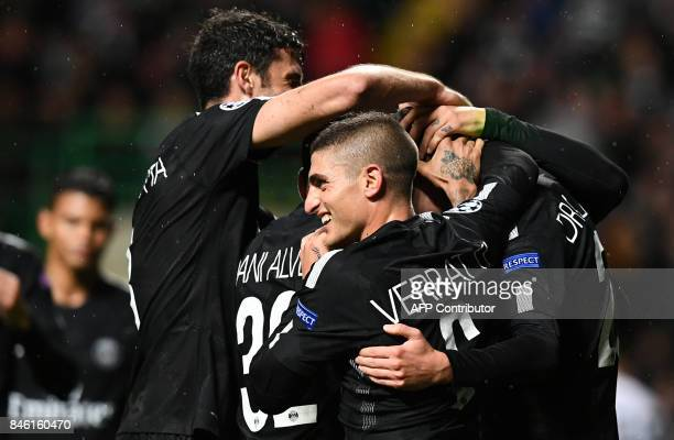 Paris SaintGermain's German midfielder Julian Draxler celebrates with teammates after creating the owngoal PSG's fourth during the UEFA Champions...