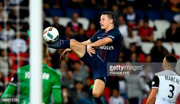 Paris SaintGermain's German midfielder Julian Draxler controls the ball in front Guingamp's Danish goalkeeper KarlJohan Johnsson during the French L1...