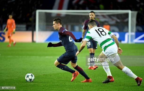 Paris SaintGermain's German midfielder Julian Draxler controls the ball past Celtic's Australian midfielder Tom Rogic during the UEFA Champions...