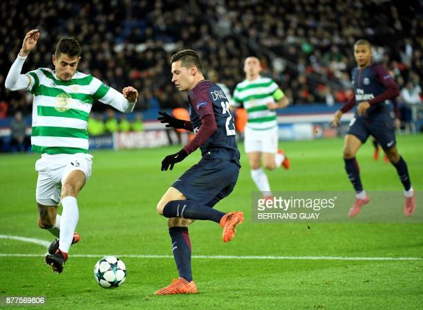 Paris SaintGermain's German midfielder Julian Draxler fights for the ball with Celtic's Israeli midfielder Nir Bitton during the UEFA Champions...