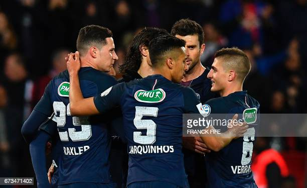 Paris SaintGermain's German midfielder Julian Draxler is congratuled by teammates after scoring a goal during the French Cup semifinal match between...