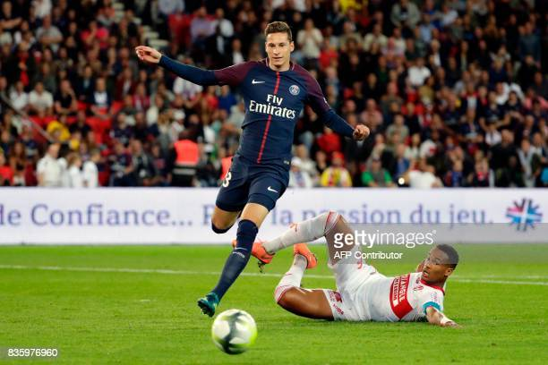 Paris SaintGermain's German midfielder Julian Draxler jumps over Toulouse's French defender Christopher Jullien during the French L1 football match...